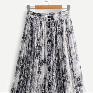 Snakeskin print button up skirt.